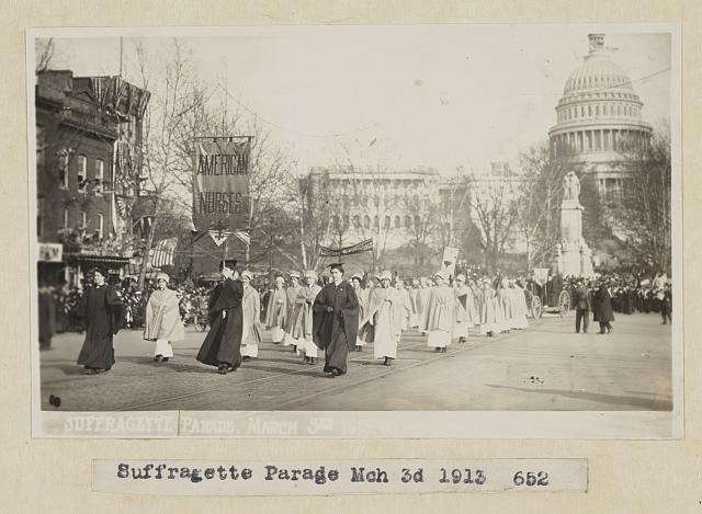 Nurses marching in 1913 women's suffrage parade in Washington, DC, with U.S. Capitol dome in the background.